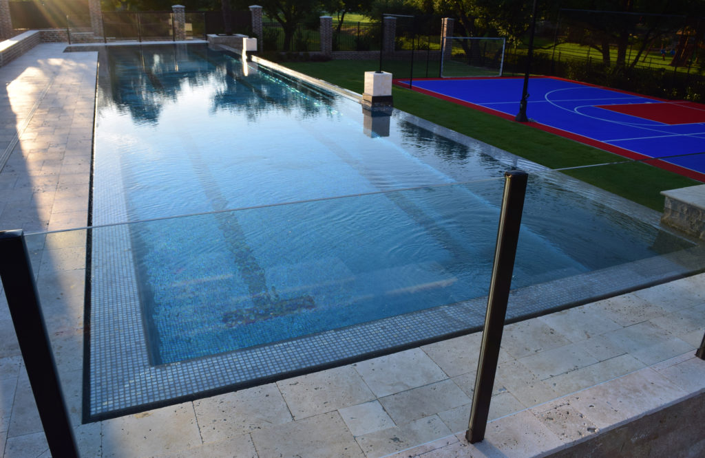 Ocean Quest presents a Zero Edge Pool With a Window - Carecraft